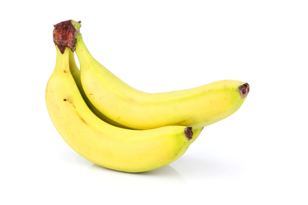 Three bananas isolated on white background.