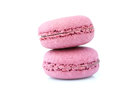 Two pink macarons cookies isolated on white background.