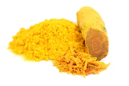 Turmeric powder and fresh root turmeric isolated on white background.