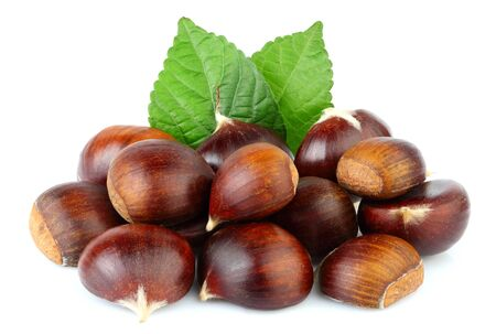 Chestnuts with chestnut leafs isolated on white background.