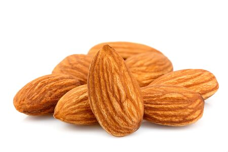 Almond nut isolated close-up on white background.