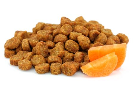 Dry food for dogs and cats with carrots.Isolated on white background. Stock Photo
