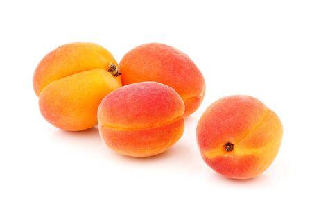 Whole ripe apricots isolated on white background.
