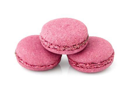 Pink macaroons cakes isolated on white background. Stock Photo