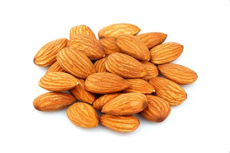 Closeup of almonds isolated on white background.