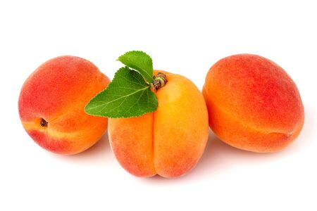 Apricots fruits with leaf isolated on white background.