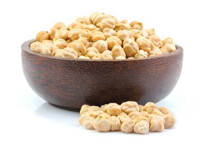 Raw chickpeas in a bowl isolated on white background.