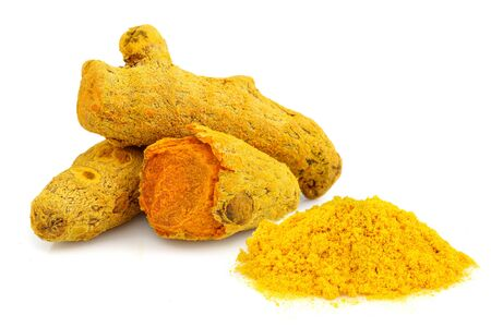 Turmeric powder and turmeric isolated on white background. Stock Photo