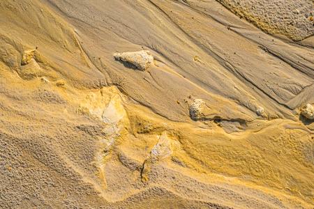 kaolin: Texture water streak on golden sand