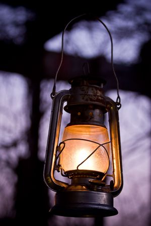 hurricane lamp: Old fashioned lantern in darkness. Light concept.