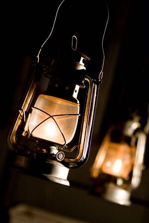 Old fashioned lantern in darkness. Light concept.   photo