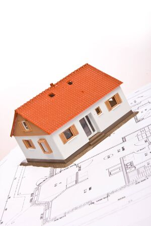Architecture model house on a blueprint
