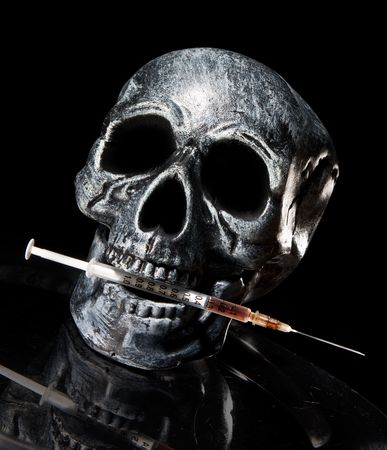 hypodermic syringes: skull with needle. Drugs kill