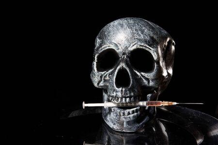 hypodermic syringe: skull with needle. Drugs kill