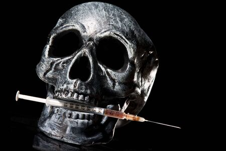 sinful: skull with needle. Drugs kill