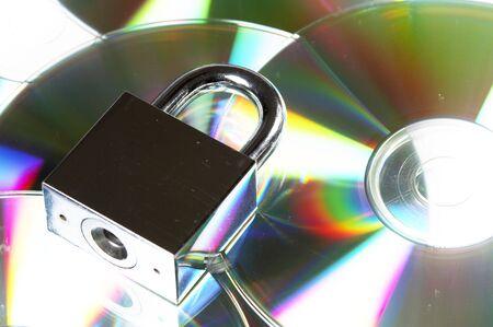 warez: concept data security with padlock on CD disc