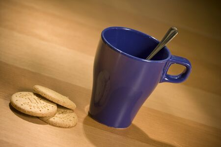 Cup of coffee and cookies photo