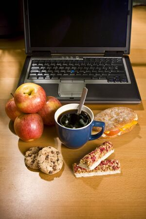 workplace wellness: Laptop computer and snack food Stock Photo