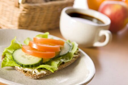 sandwich with tomato and salad close up photo