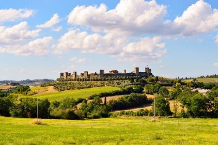 View of the town of Monteriggioni a small village near Siena and the surrounding nature