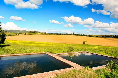 refelction: Tuscan landscape with fountain and hills