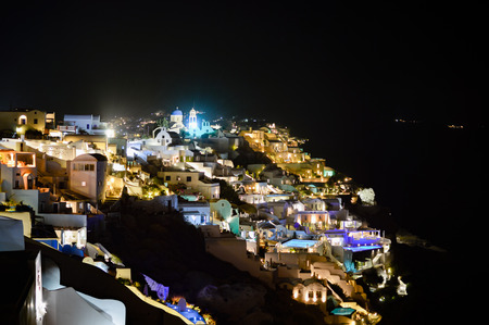 thira: A scenic night view of the City of Thira in Santorini with its lights