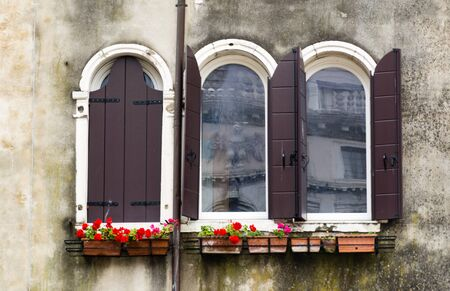 Building facade in Venice with flowers Stock Photo