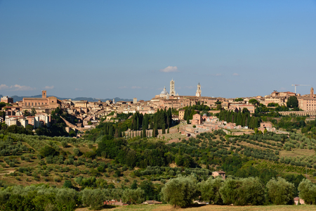 View of the city of Siena from the surrounding countryside Stock Photo