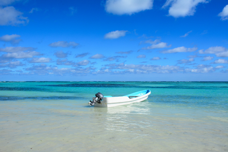 cana: Paradise caribbean landscape with a crystal sea water and a boat