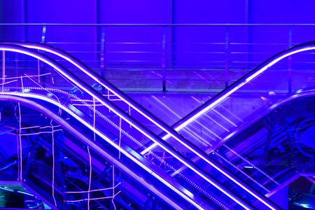 Colorful escalators  lit by  neons