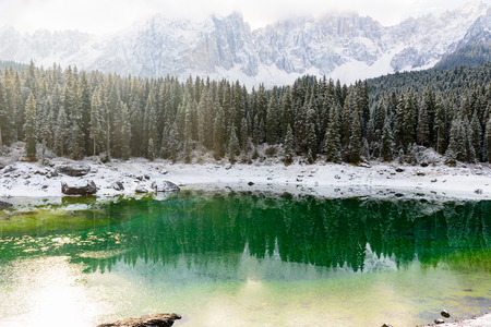 autumn color: Scenic view of lake karersee Stock Photo