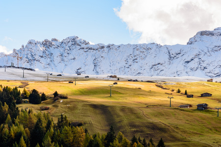ski run: View of colors of Dolomites in autumn with a ski run waiting for the snow. Stock Photo