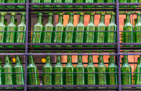 identical: Empty green bottles,  ready for recycling.