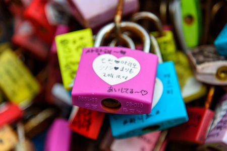 SEOUL, SOUTH KOREA - DECEMBER 31, 2016 - A padlock attached to a fence of the Seoul Tower with a promise of eternal love. Editorial