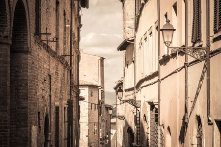 View of a street in the historic district of Colle Val dElsa a small town near Siena in Tuscany