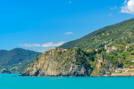 Scenic view of the mediterrean sea and a town inside the Cinque Terre National Park, Liguria, Italy from the cliffs near Manarola.