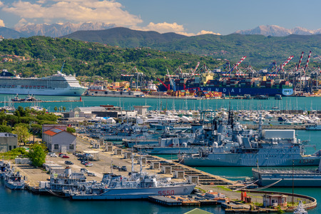 unloading: LA SPEZIA, ITALY - APRIL 29, 2017 - View of the port of La Spezia with boats and mountains at the horizon. Editorial
