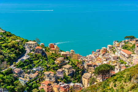 Aerial view of Riomaggiore in Liguria a famous town of the Cinque Terre National Park. Фото со стока