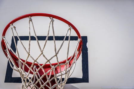Basketball hoop with blue sky.