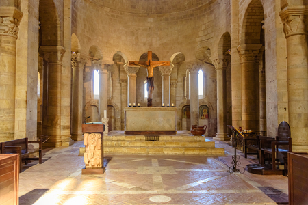 MONTALCINO, ITALY - JULY 22, 2017 - The altar of the ancient Romanesque church of SantAntimo near Montalcino in Tuscany Editorial