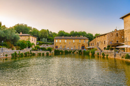 BAGNO VIGNONI, ITALY - JULY 23, 2017 - View of the medieval thermal baths in Bagno Vignoni a small village in ValdOrcia. Editorial