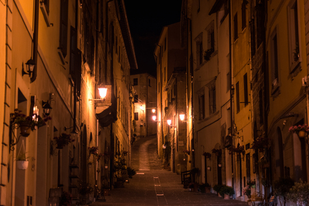 MASSA MARITTIMA, ITALY - MAY 14, 2017 - Night view of a street in the historic center of Massa Marittima in the province of Grosseto in Tuscany. Editorial