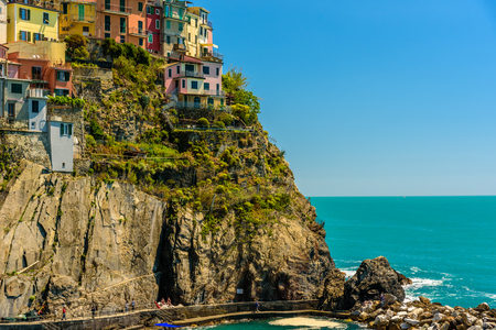 MANAROLA, ITALY - APRIL 29, 2017 - View of some colorful houses in the famous town of Manarola inside the Cinque Terre National Park. Editorial