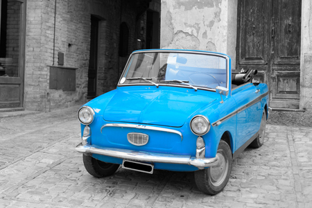spello: An italian vintage car parked in a street of the historical center of Spello in Umbria.