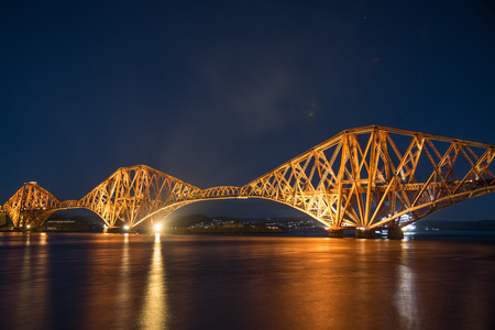 Night view of the Forth Rail Bridge in Edinburgh. The bridge that connects the scottish towns of North and South Queens ferry Editorial
