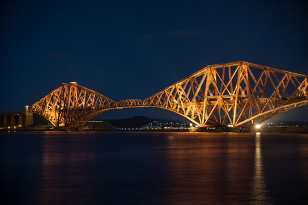 Night view of the Forth Rail Bridge in Edinburgh. The bridge that connects the scottish towns of North and South Queens ferry Stock Photo
