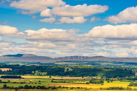 View of the countryside from the top of the Stirling Castle in Scotland, United Kingdom with poles for wind energy at the horizon. Editorial