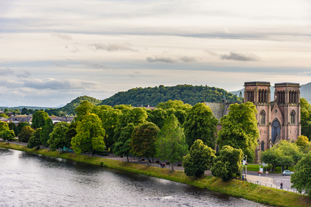 ness river: INVERNESS, SCOTLAND - AUGUST 11, 2017 - View of the city of Inverness at sunset. Editorial