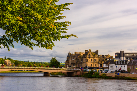 ness river: INVERNESS, SCOTLAND - AUGUST 11, 2017 - View of the city of Inverness at dusk.