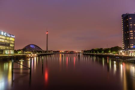 GLASGOW, SCOTLAND - AUGUST 15, 2017 - Night lights reflection in Glasgow City near the headquarters of BBC Scotland.